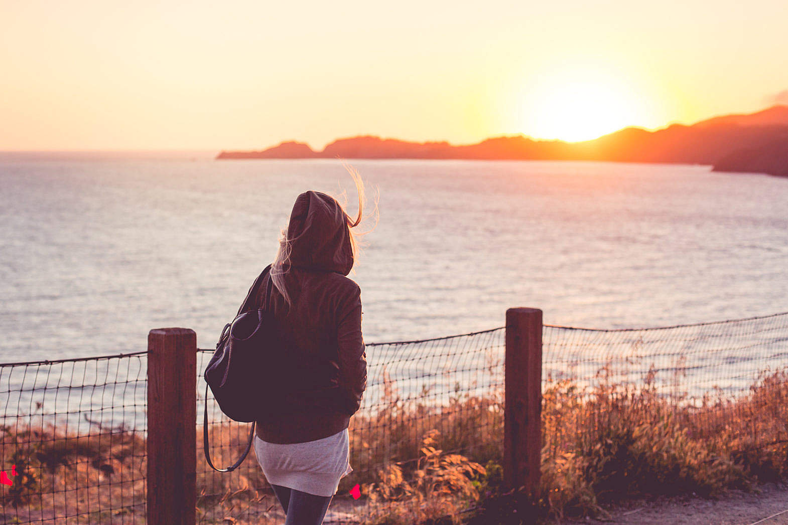 young-girl-on-a-walk-near-the-shore-at-sunset_free_stock_photos_picjumbo_hnck2769-1570x1047.jpg