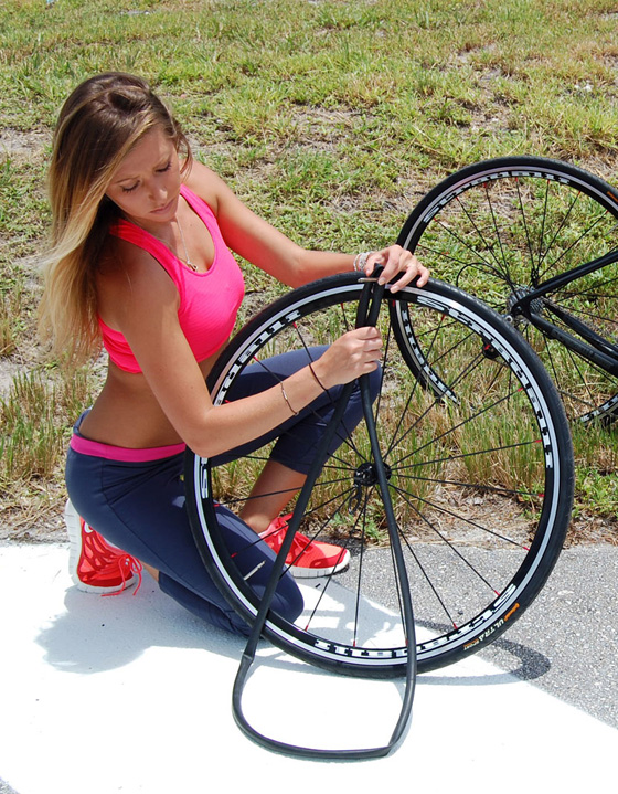 Playboy model Gwen Barker fixing a tire on Stradalli Palermo limited edition 3.jpg