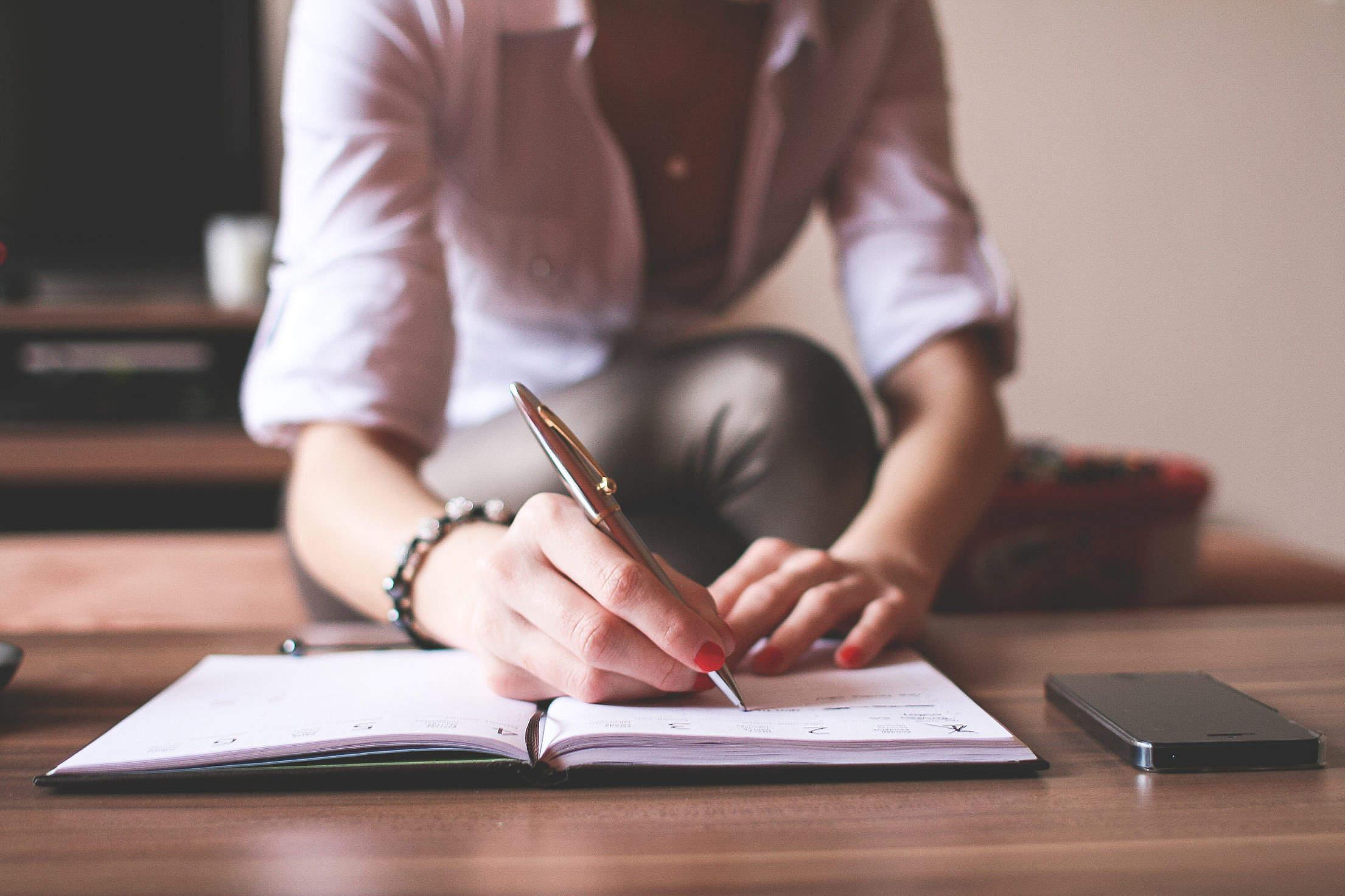 girl-writing-in-a-diary_free_stock_photos_picjumbo_img_6037-2210x1473.jpg