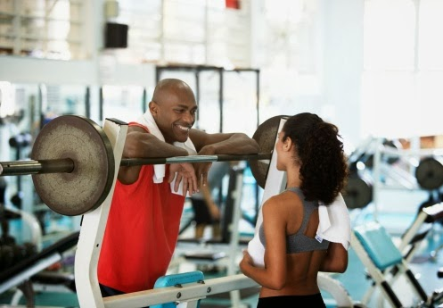 72894508-woman-and-man-talking-in-gym-gettyimages.jpeg