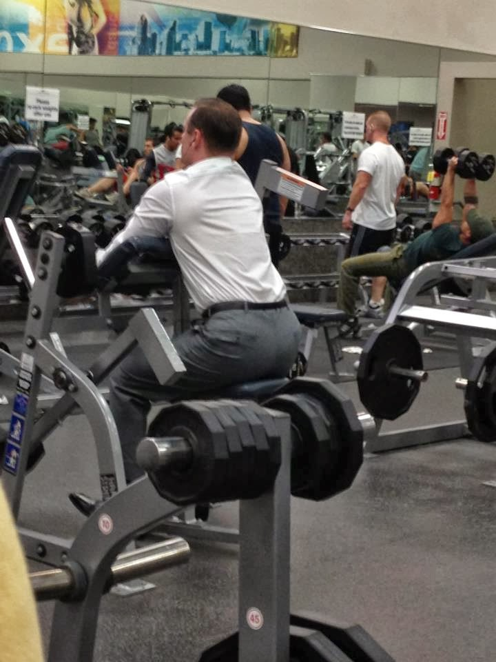 executive_at_gym_guy_in_suit.jpg