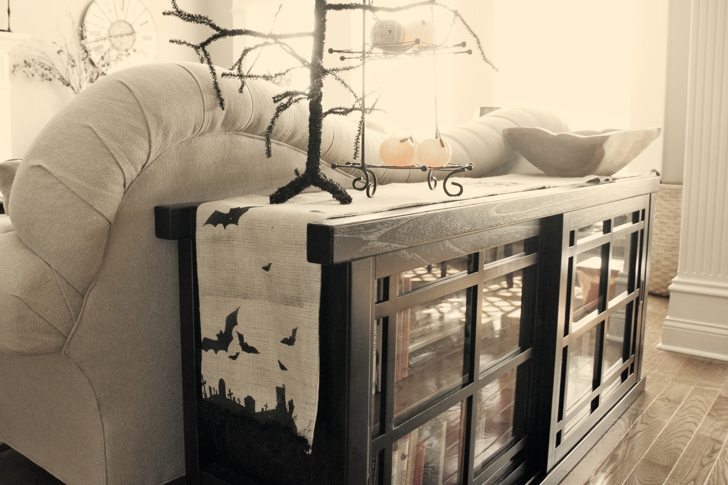 best-halloween-decorating-ideas-indoor-with-black-glass-cup-board-combined-dark-dry-tree-also-unique-shape-bowl-combined-white-bats-fly-tufted-drapery-for-living-room-design-halloween-decorating-ideas.jpg