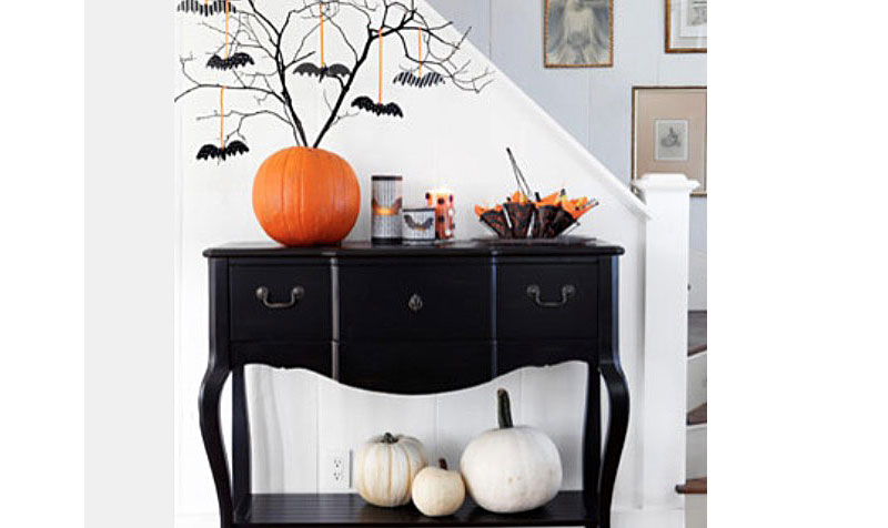 bewitching-accessories-room-with-creepy-halloween-decorations-using-pumpkin-vase-shape-in-orange.jpg