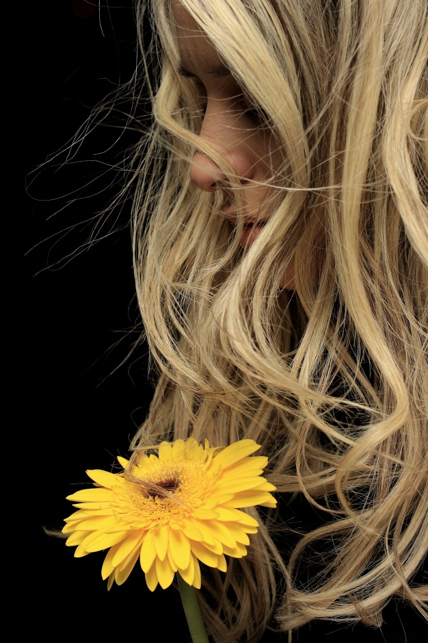 close-up-of-pensive-woman-with-yellow-flower_1122-1485.jpg