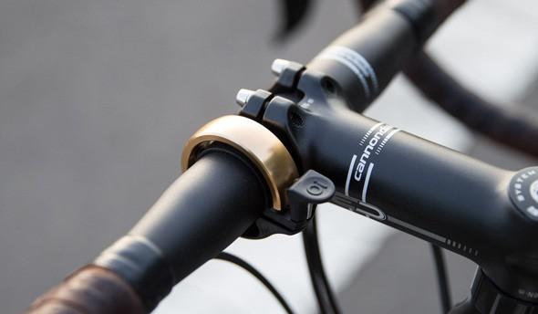 brass_oi_on_bike.jpg