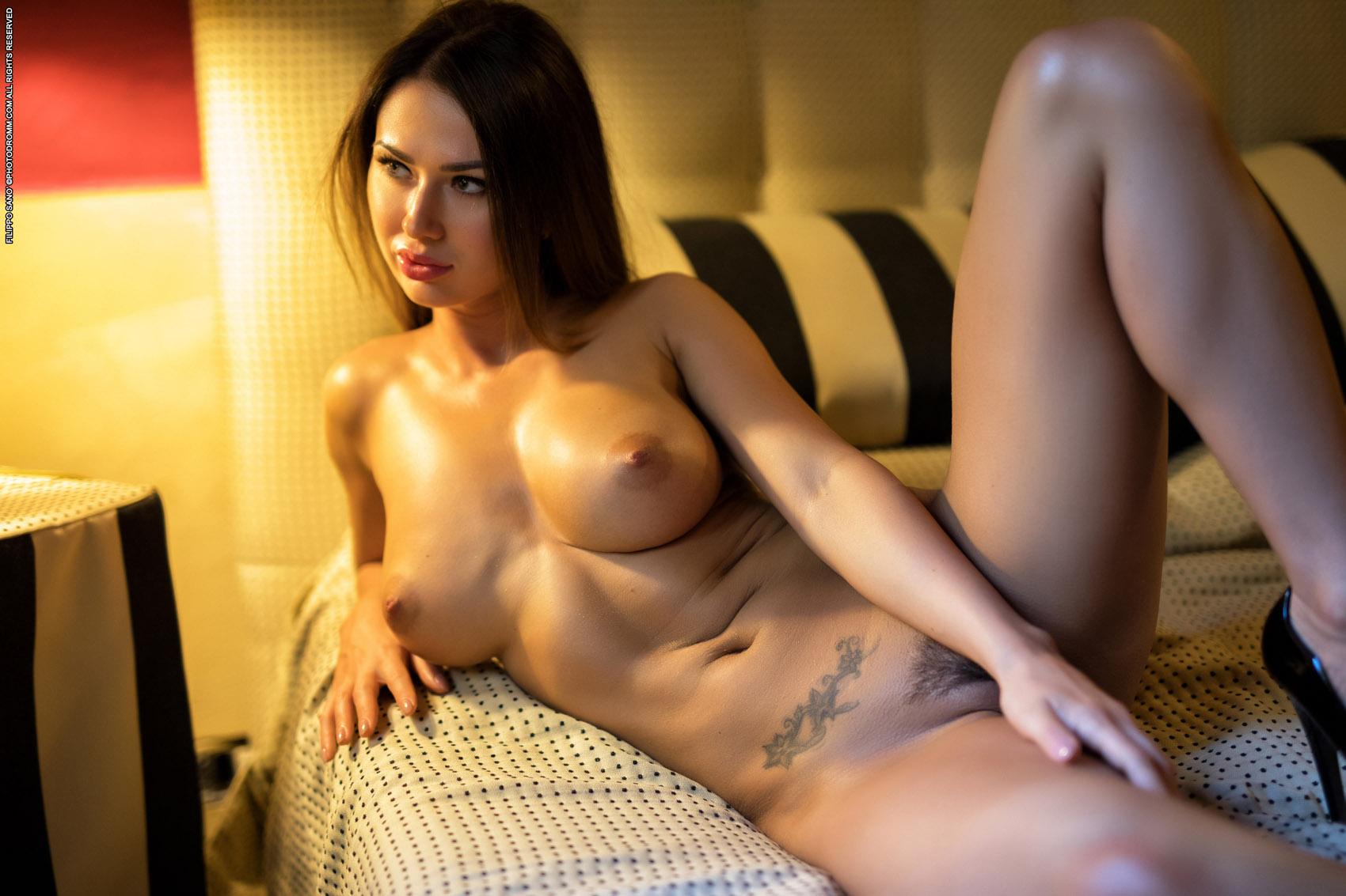 busty-shaved-brunette-goddess-justyna-with-big-naturals-wearing-fishnet-10.jpg
