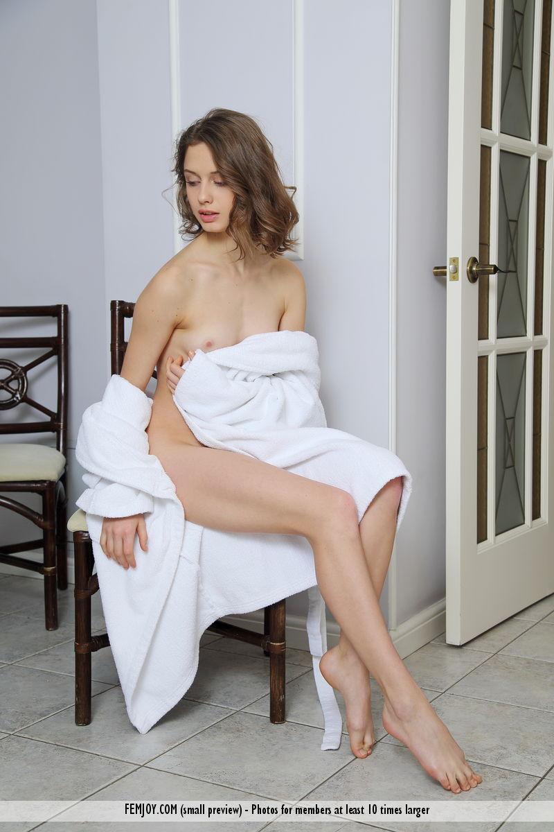 gorgeous-brunette-elvira-u-shows-us-her-tight-shaved-pussy-01.jpg