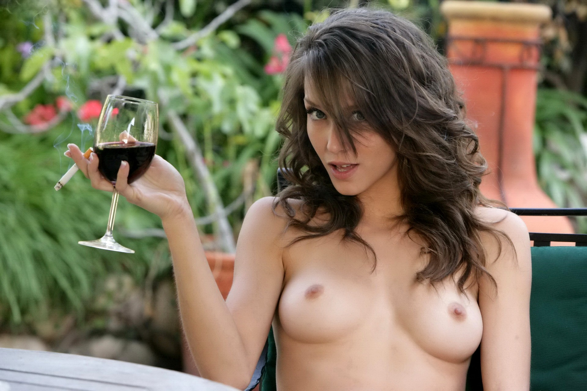 shaved-gorgeous-brunette-babe-malena-morgan-with-outie-belly-button-in-garden-2.jpg