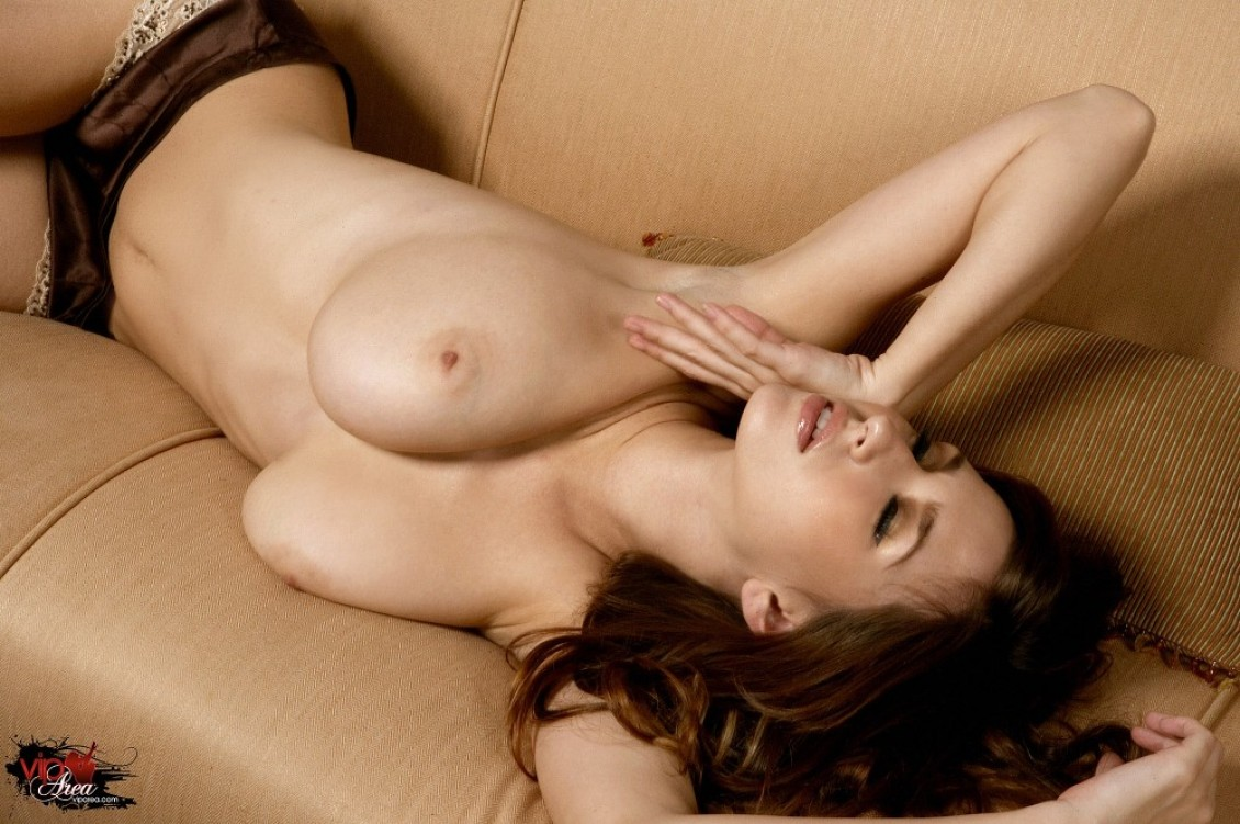 busty-shaved-brunette-andie-valentino-with-open-pussy-wearing-satin-15.jpg