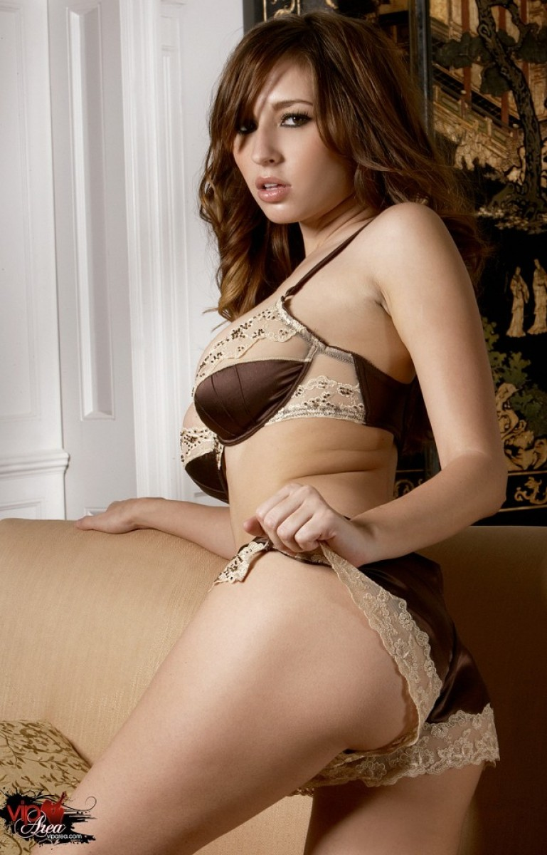 busty-shaved-brunette-andie-valentino-with-open-pussy-wearing-satin-5.jpg