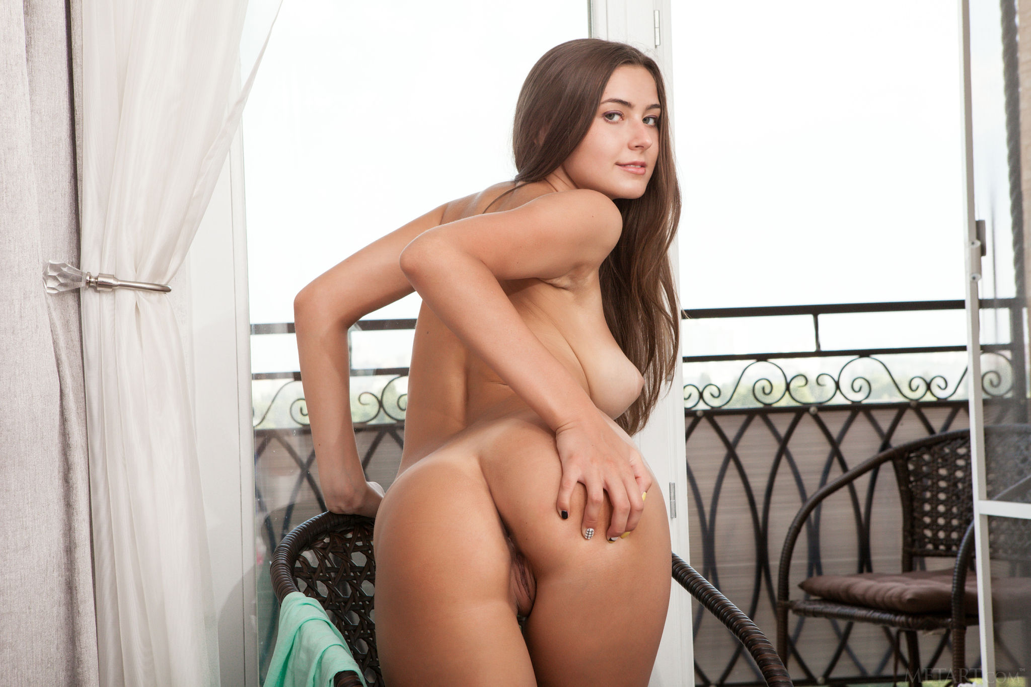 busty-shaved-brunette-muse-with-tanlines-from-met-art-16.jpg