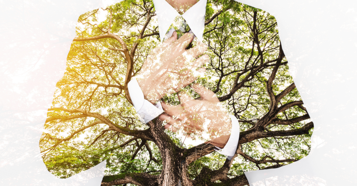 05_13_-double-exposure-businessman-in-suit-with-big-tree-with-bright-sunlight.jpg