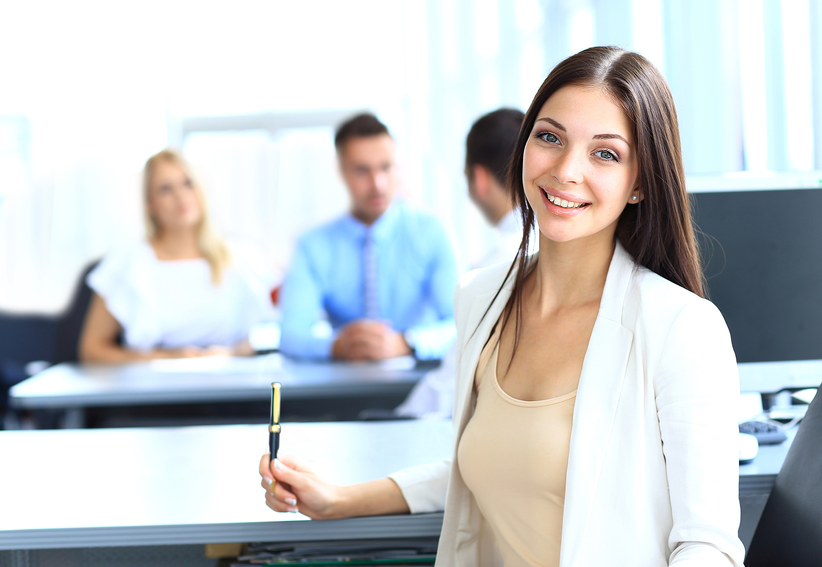 bigstock-business-woman-with-her-team-a-48958436.jpg