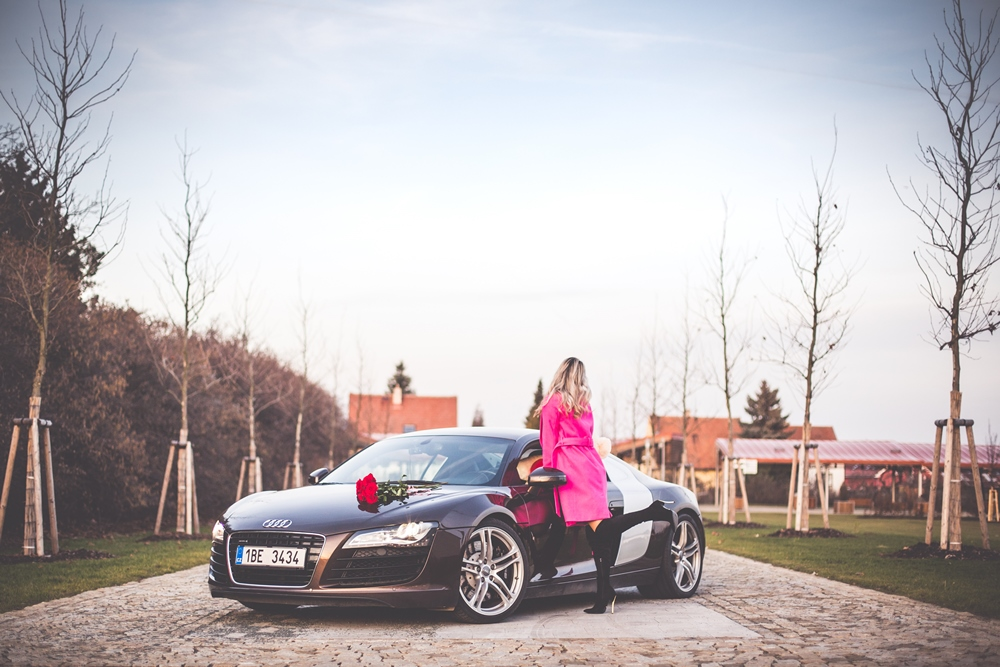 woman-in-pink-coat-standing-next-to-a-supercar-picjumbo-com.jpg