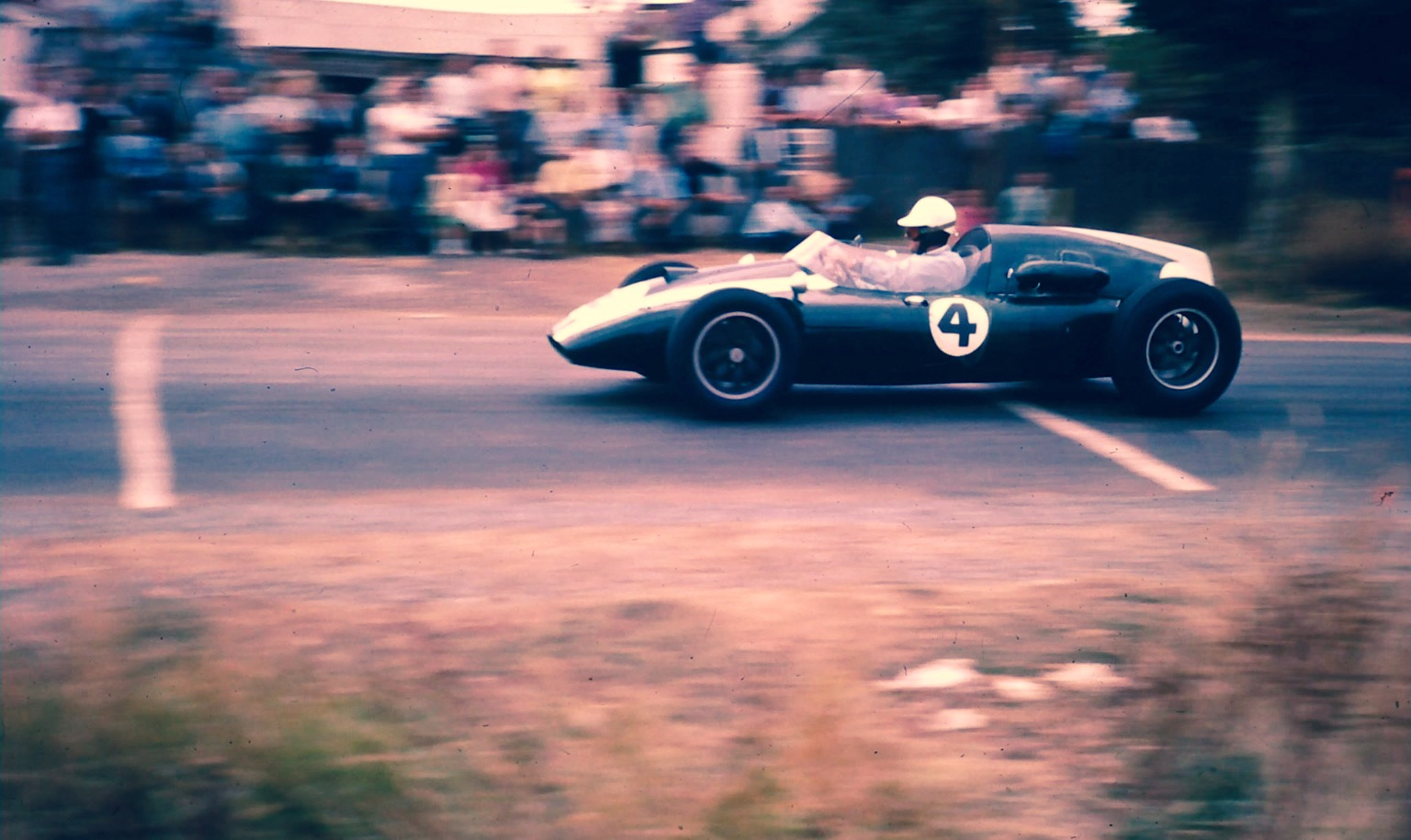 jack-brabham-cooper-t51-climax-on-the-approach-to-pub-corner-longford-1960.jpg
