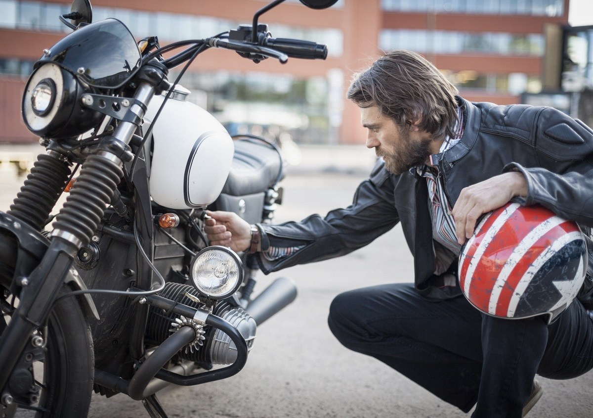 man-looking-at-motorcycle_getty_resized.jpg