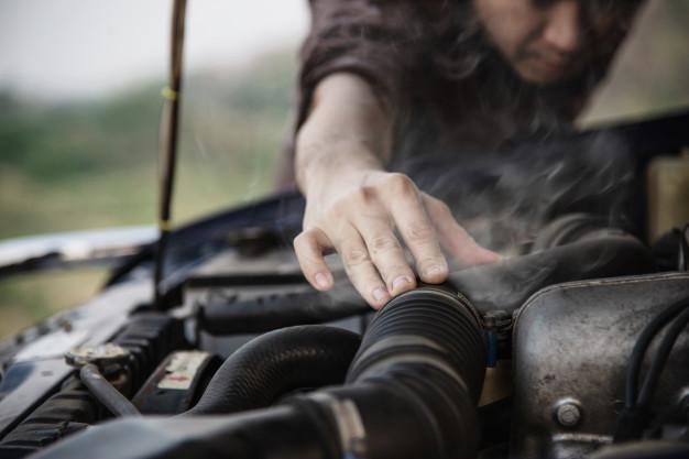 man-try-fix-car-engine-problem-local-road_1150-10665.jpg