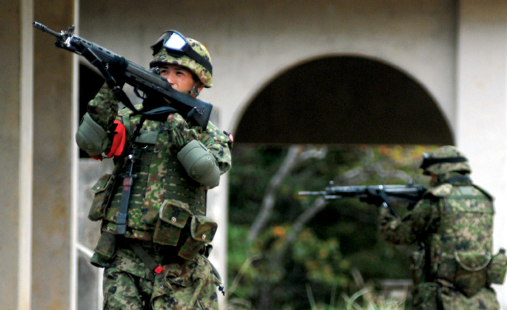 Japan_Ground_Self_Defense_Force_soldiers_patrol_through_the_Central_Training_Area's_combat_town_March_17._The_JGSDF_recently_started_using_the_CTA_for_training_in_accordance_with_the_U.S._-_Japan_Alliance.jpg