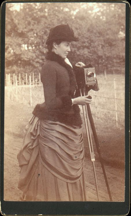 ca_1890_s_cabinet_card_portrait_of_a_woman_with_a_camera_via_the_metropolitan_museum_of_art_photographs_collection.jpg
