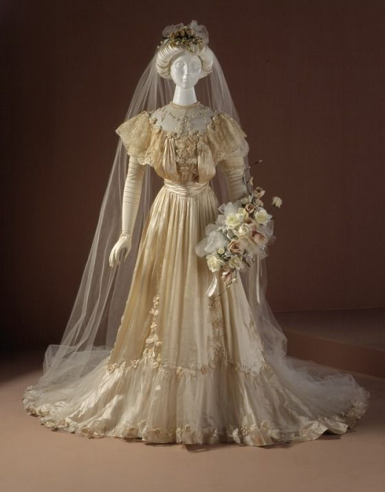 for_a_beautiful_edwardian_june_bride1905silk_satin_taffetatulle_and_ribbon_appliquelinen_bobbinlacegown_from_lacma.png