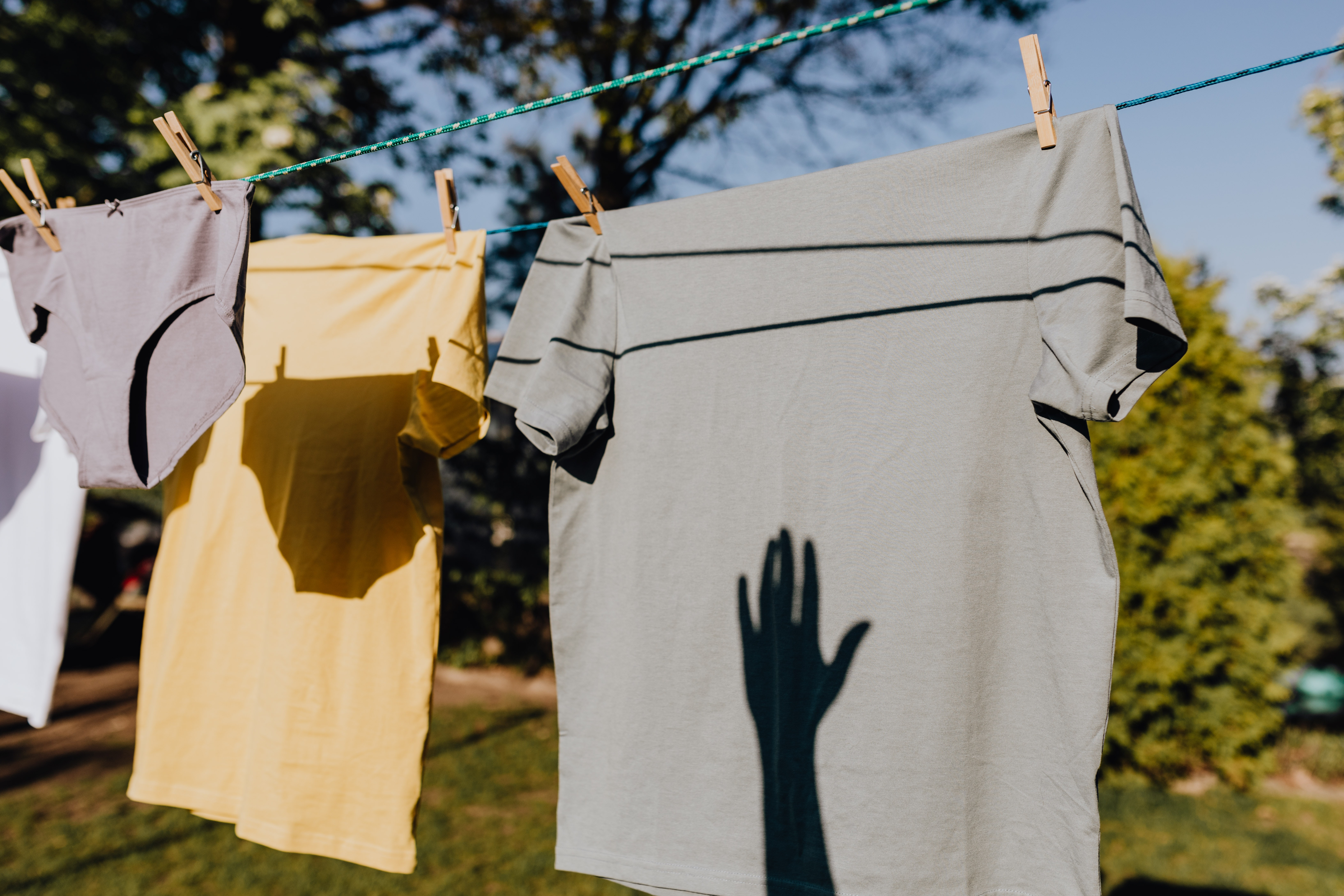 clothes-drying-on-rope-with-clothespins-in-garden-4495705.jpg