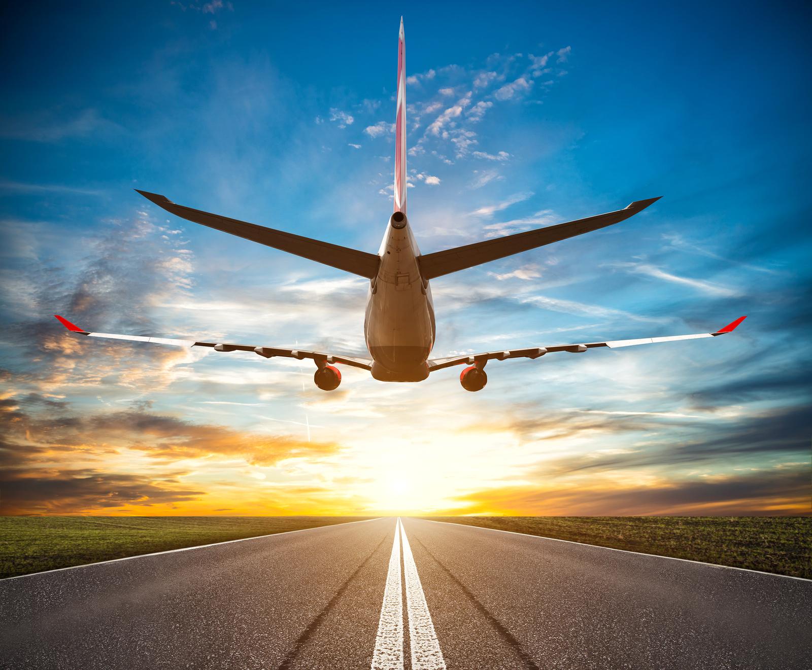bigstock-passenger-plane-fly-up-over-ta-168459098.jpg