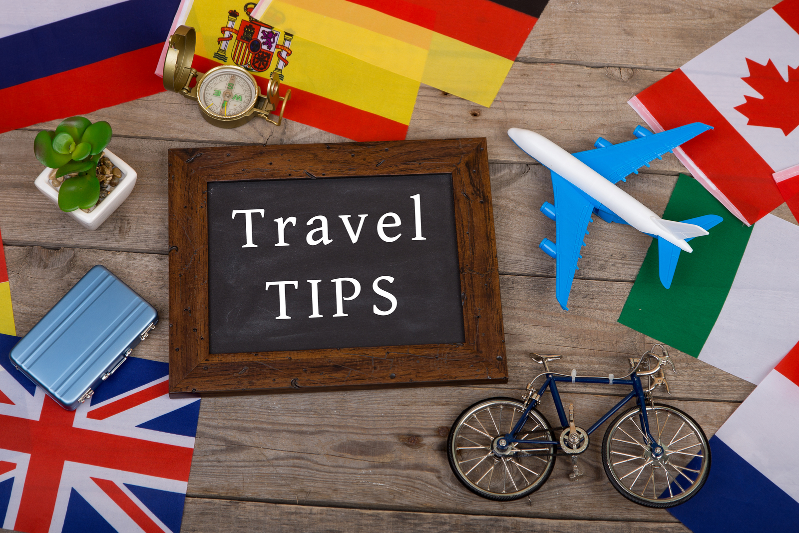 bigstock-travel-time--blackboard-with--211766170.jpg