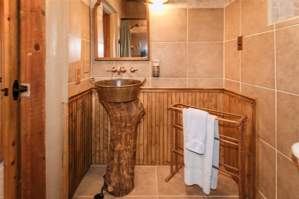 eclectic-powder-room-with-vessel-sink-and-wainscoting-i_g-ishzqn15kscsu40000000000-qbkm3.jpg