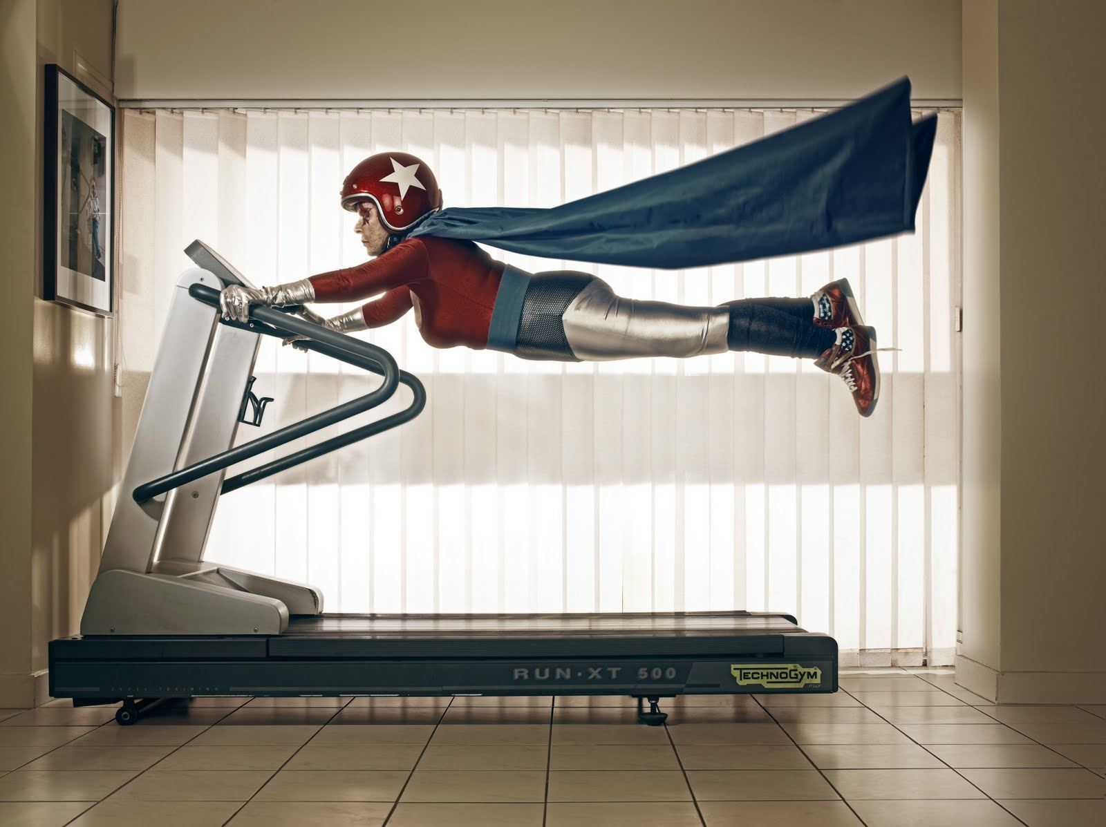 a-funny-photo-by-sacha-goldberger-of-his-grandmother-in-a-superhero-outfit-flying-on-a-treadmill.jpg