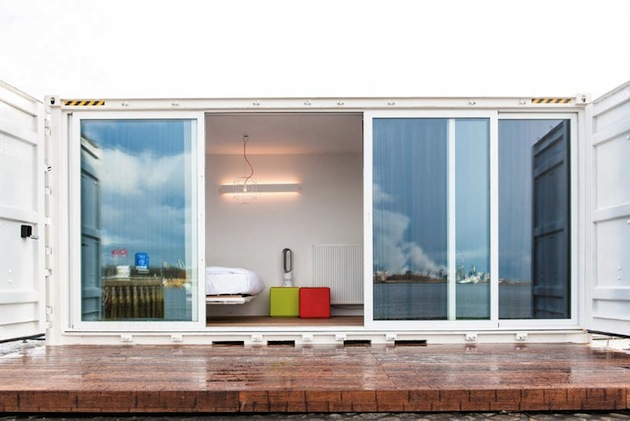 7 shipping containers with four rooms and the other three being a lounge sauna kitchen and breakfast space.jpeg