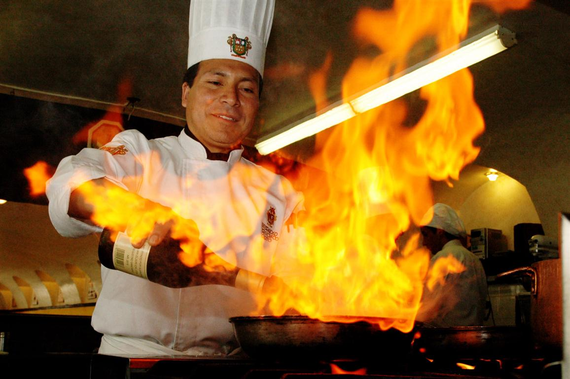 A-master-chef-cooking-with-gas-and-wine.jpg