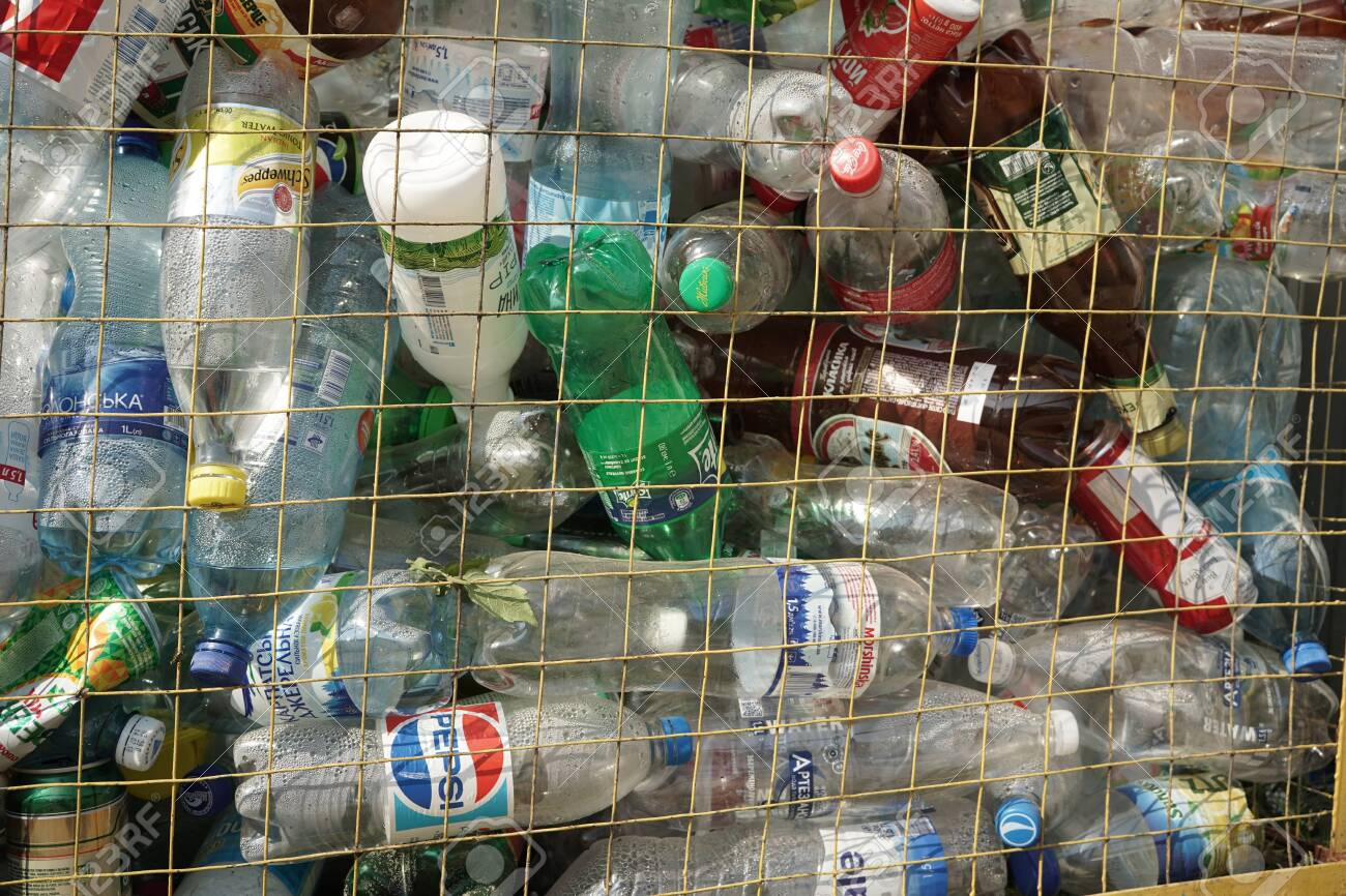 150804873-plastic-bottles-in-a-trash-can-container-with-bottles-from-pepsi-sprite-schveppes-and-also-from-wate.jpg