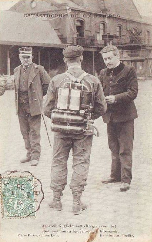rescue_service_member_with_breathing_equipment_stands_by_during_the_courrieres_mine_disaster_which_caused_the_death_of_1099_miners_in_northern_france_1906_12149.jpg