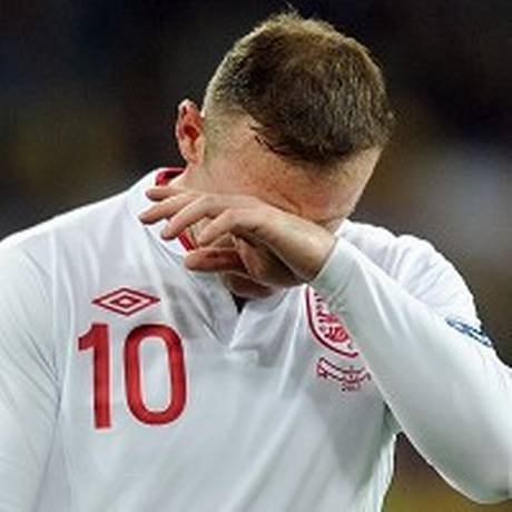 Wayne Rooney was obviously disappointed with England's penalty shoot-out defeat at Euro 2012.jpg