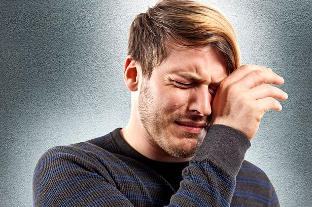 man-crying-with-hand-to-face.jpg