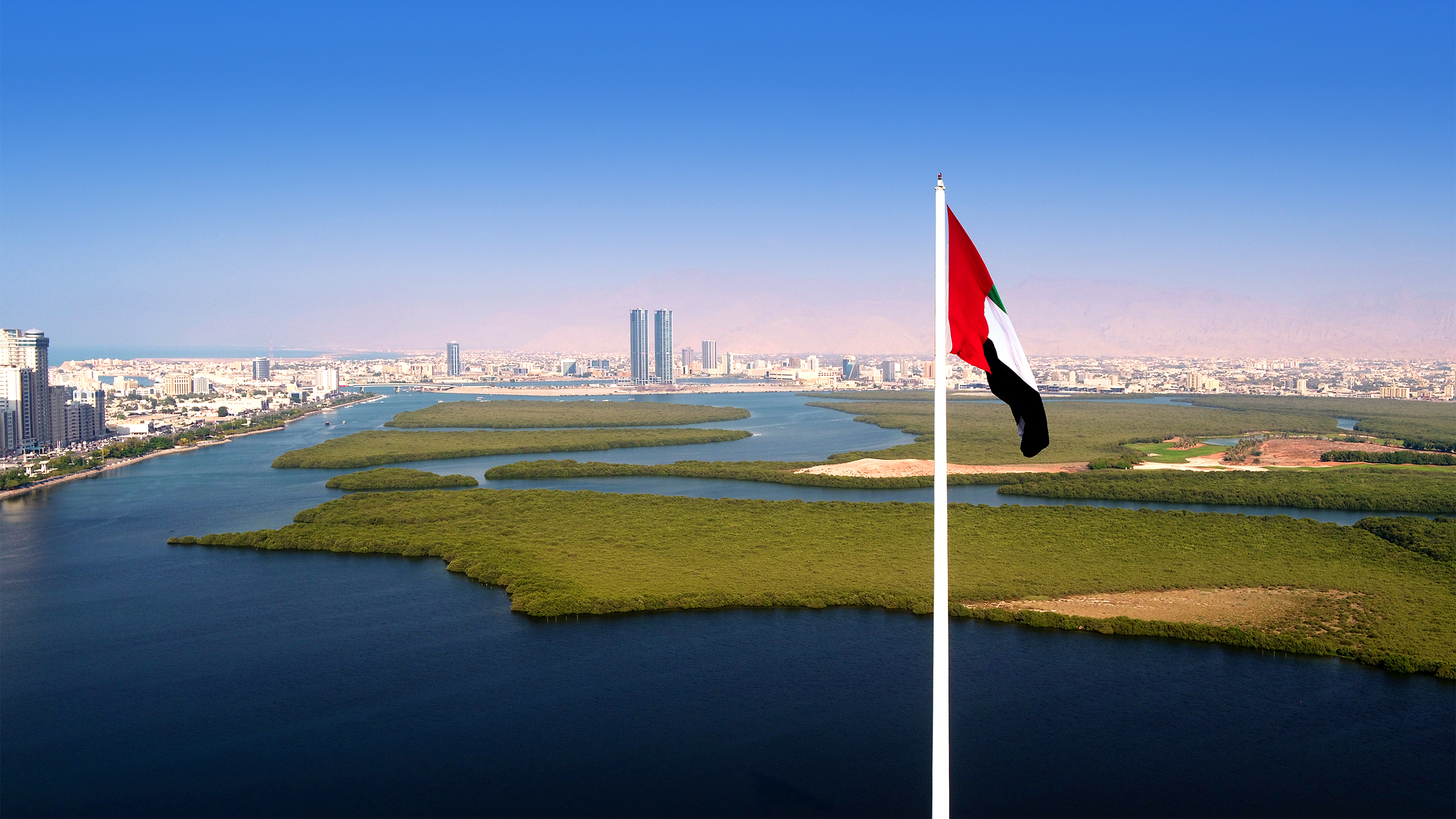 aerial_view_of_rak_city_from_al_qawasim_corniche_flagpole.jpg