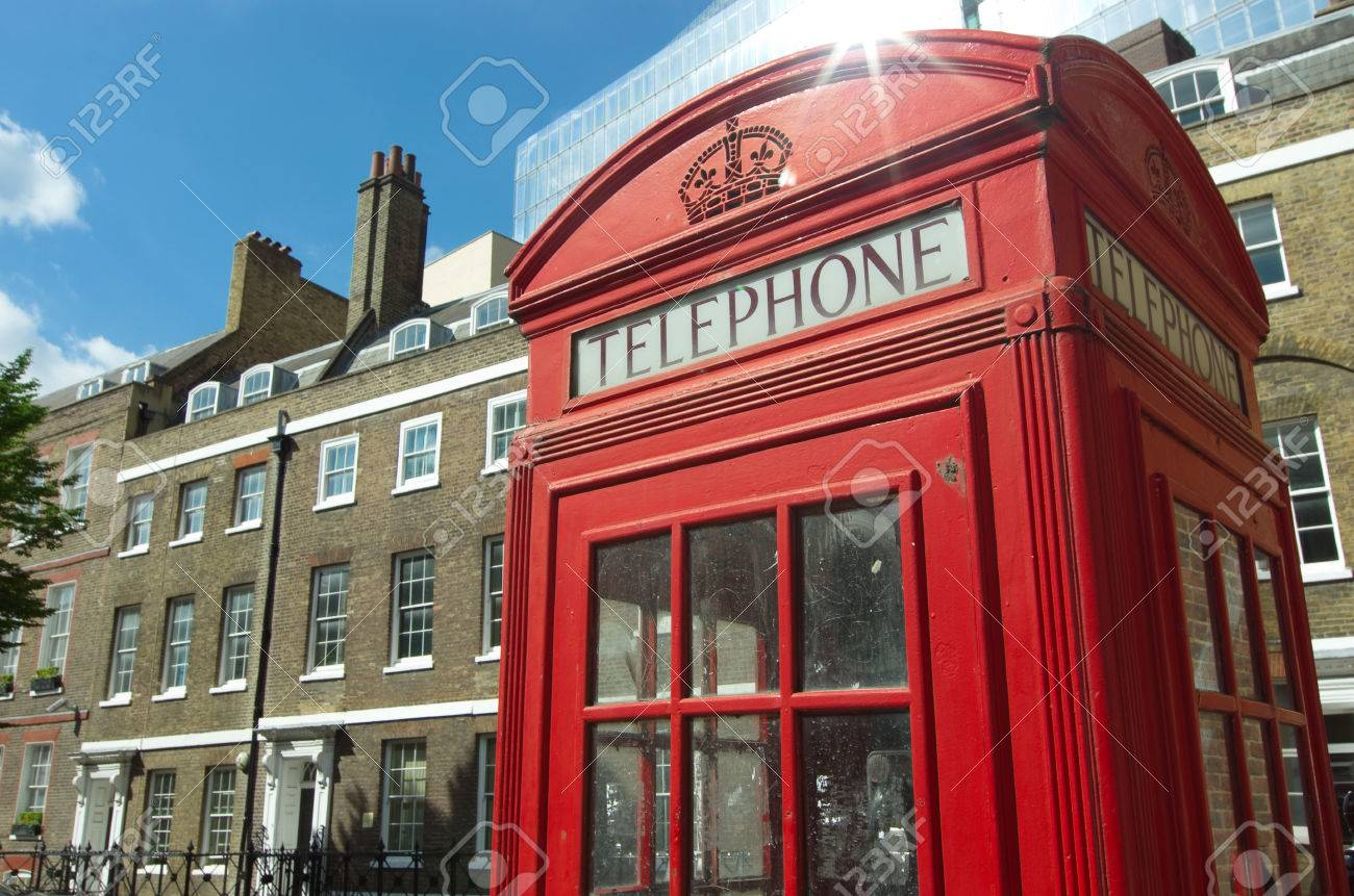 22201782-red-phone-booth-in-old-style-and-typical-brick-building-in-london.jpg