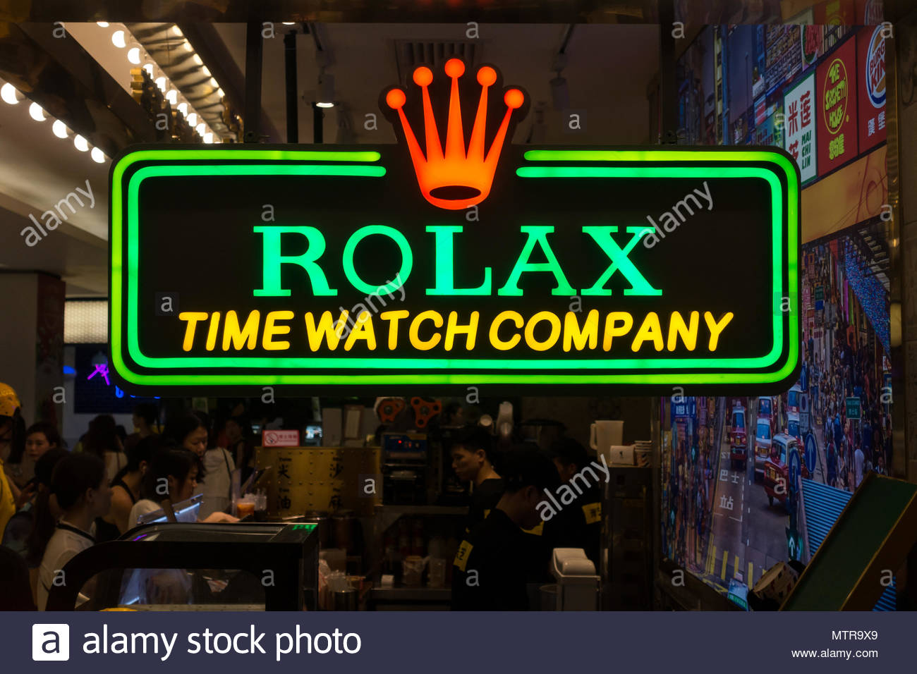 fake-or-counterfeit-goods-and-products-sold-in-china-store-sign-with-rolex-misspelled-mtr9x9.jpg