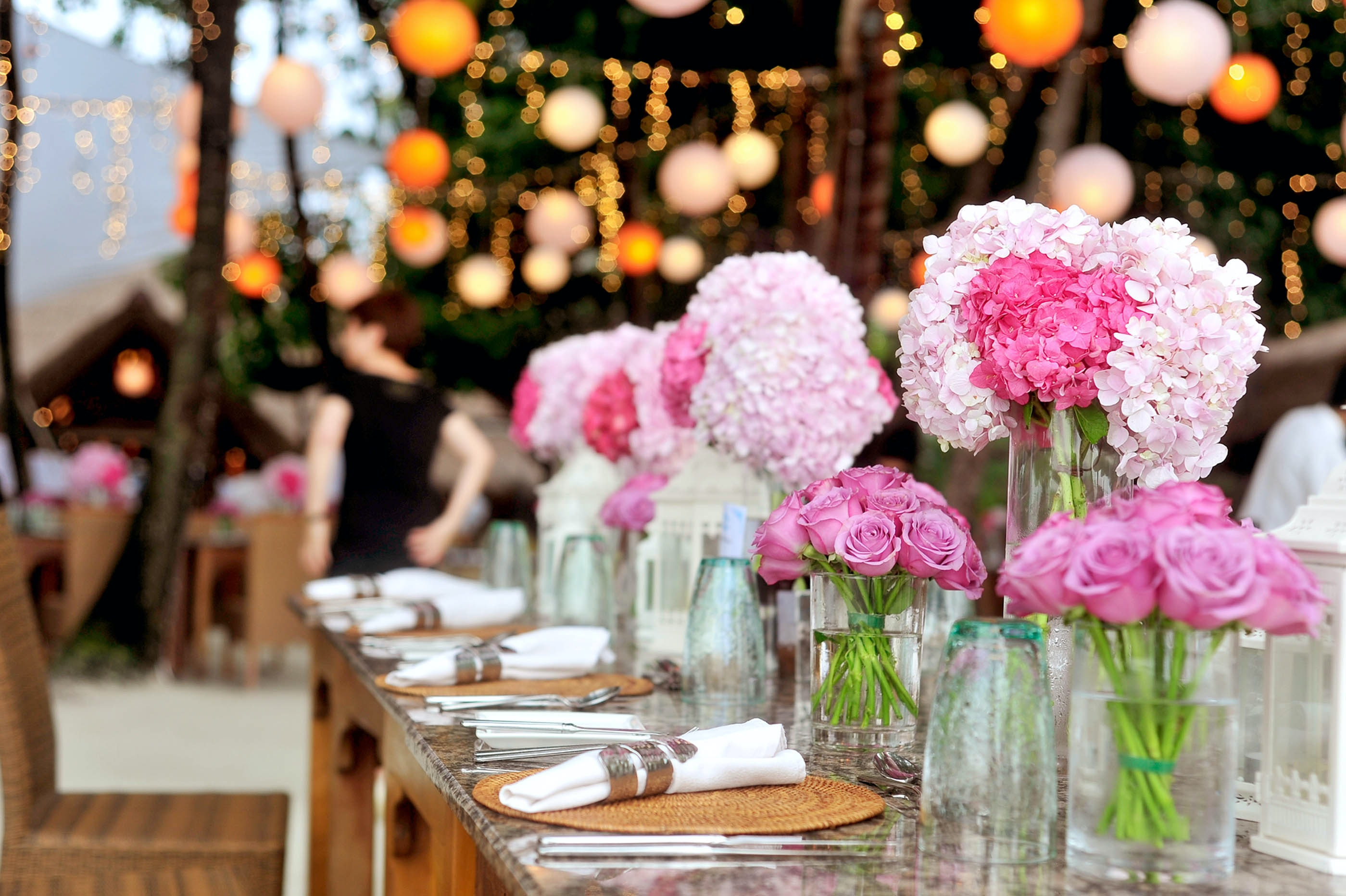 table-with-plates-and-flowers-filed-neatly-selective-focus-169190.jpg