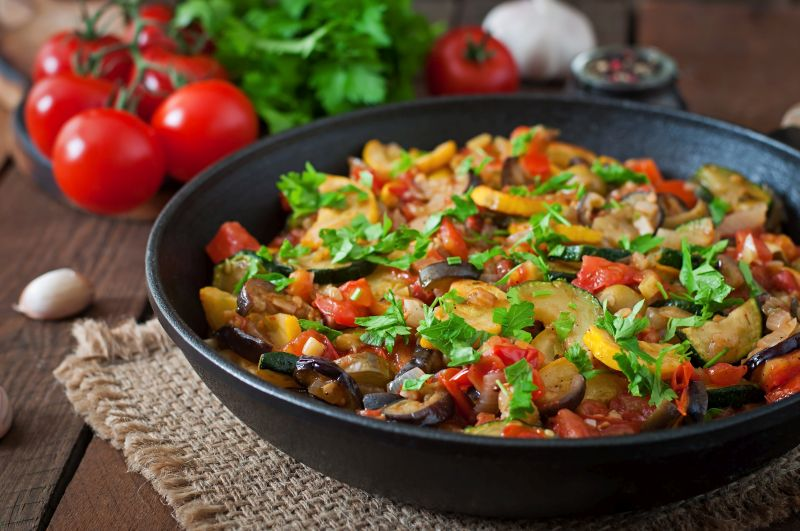 ratatouille-frying-pan-wooden-table.jpg