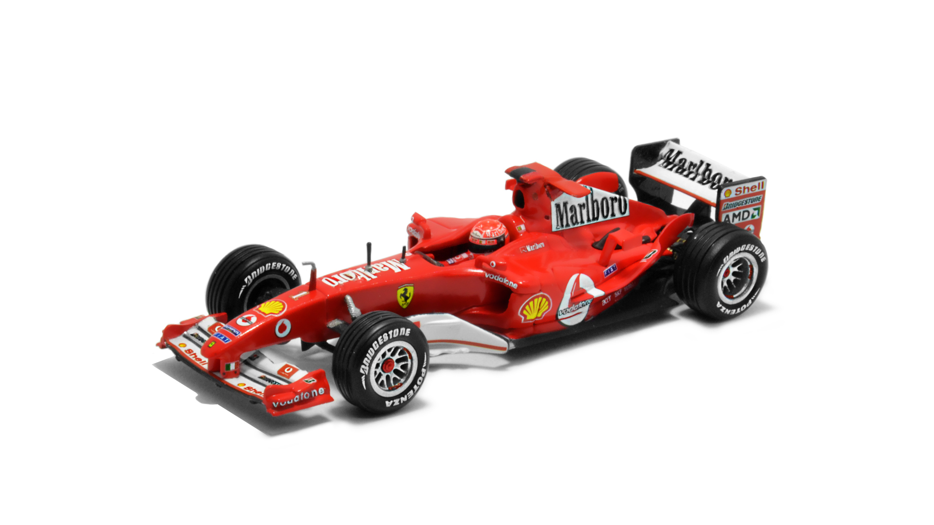 Év: 2004<br />Modell: F2004<br />Gyártó: Hot Wheels<br />Pilóta: Michael Schumacher