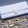 Aranyozott Lego kockákkal díszített táskához mit szólna?