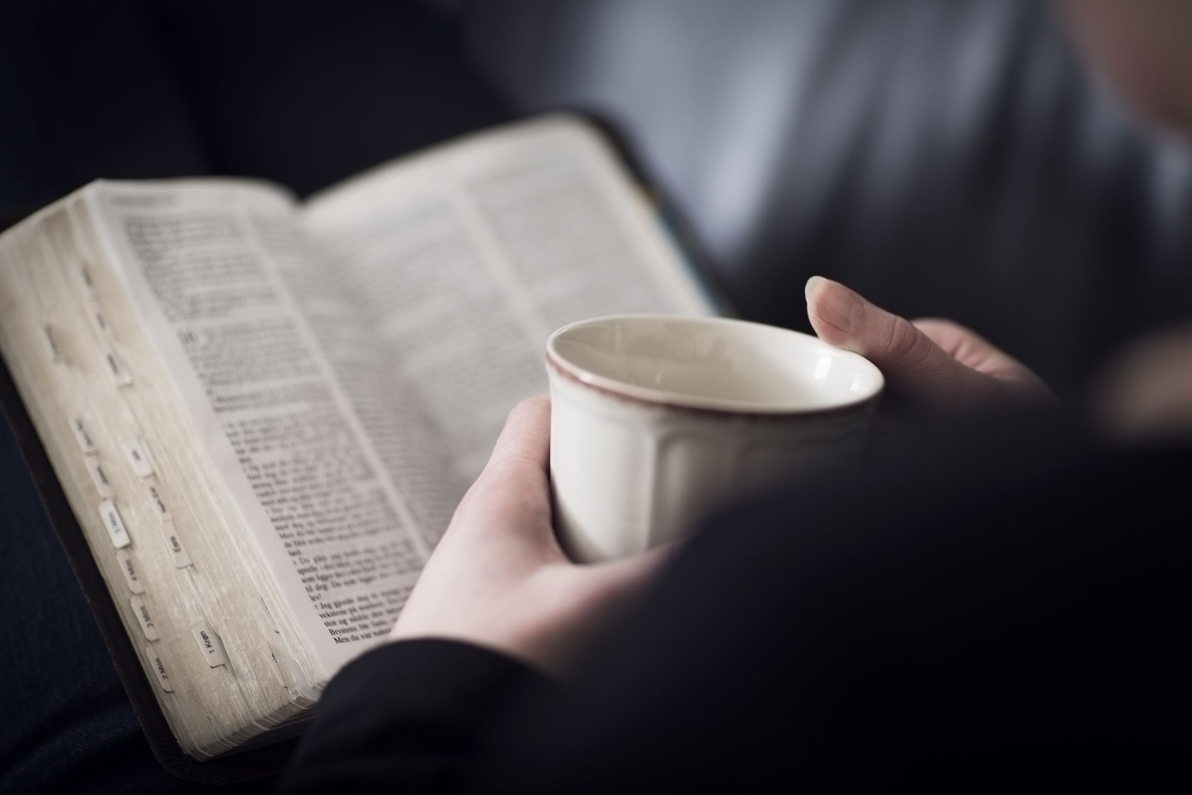 123rs19200854_ml-copy-woman-reading-biblecup-in-hand.jpg