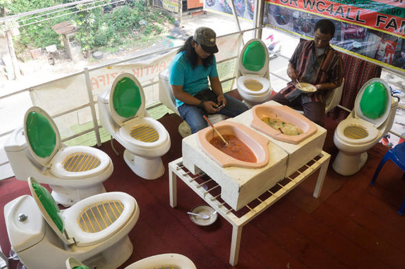 diners-tuck-into-food-at-toilet-themed-cafe-590056.jpg