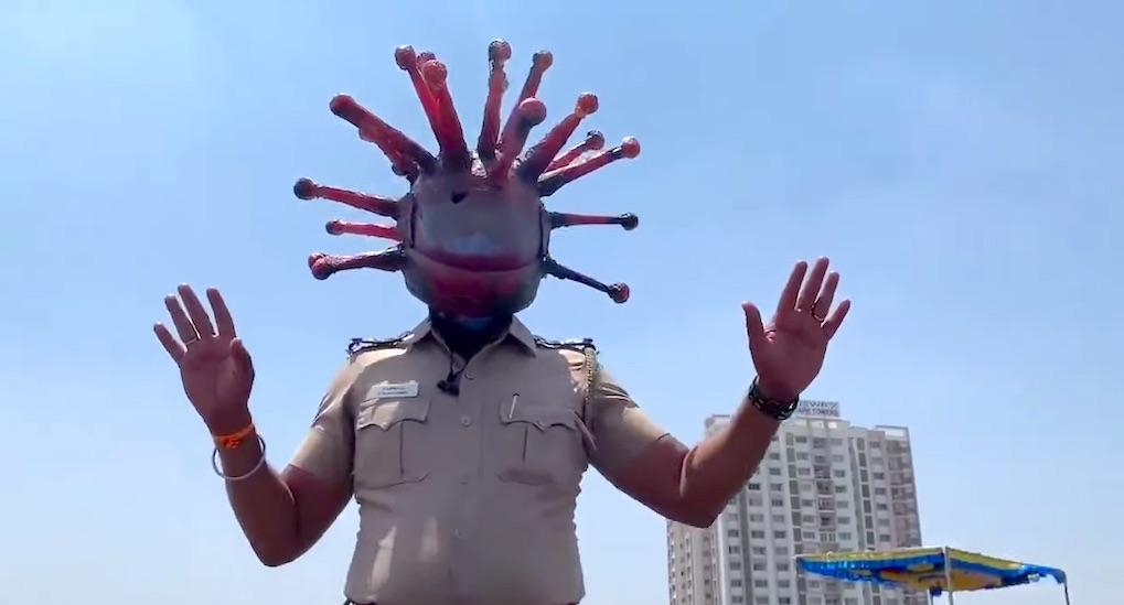 police-inspector-in-india-wears-coronavirus-helmet.jpg