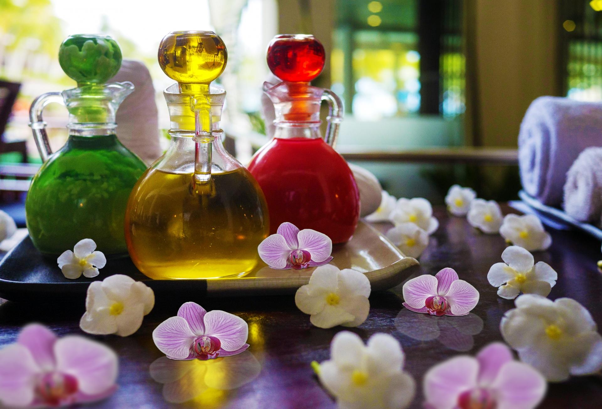 massage-oils-nestled-in-orchids.jpg