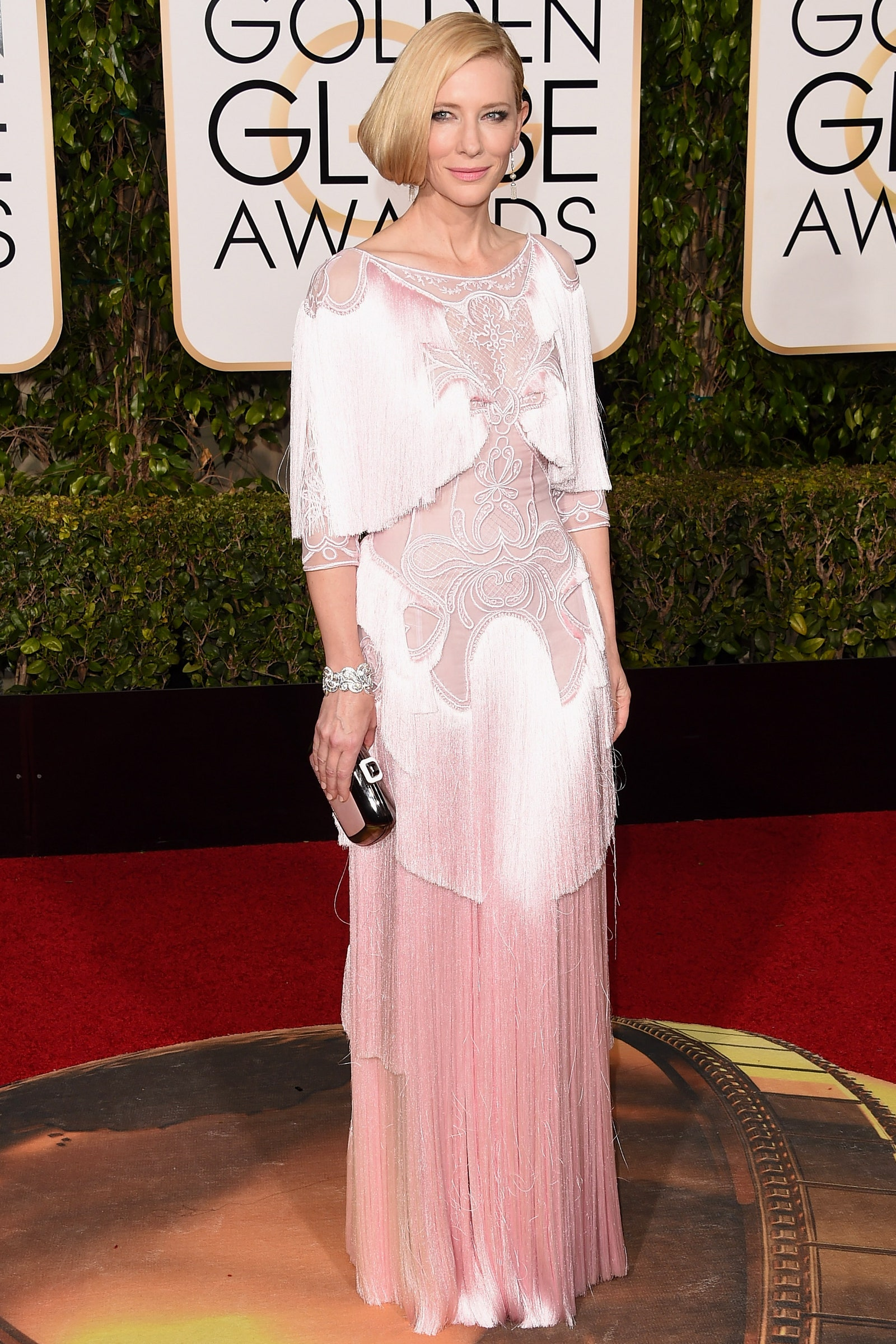 38_cementing_her_status_as_a_fashion_icon_blanchett_wore_a_blush-pink_givenchy_number_with_dazzling_embroidery_and_fringe_detail_golden_globes_2016.jpg