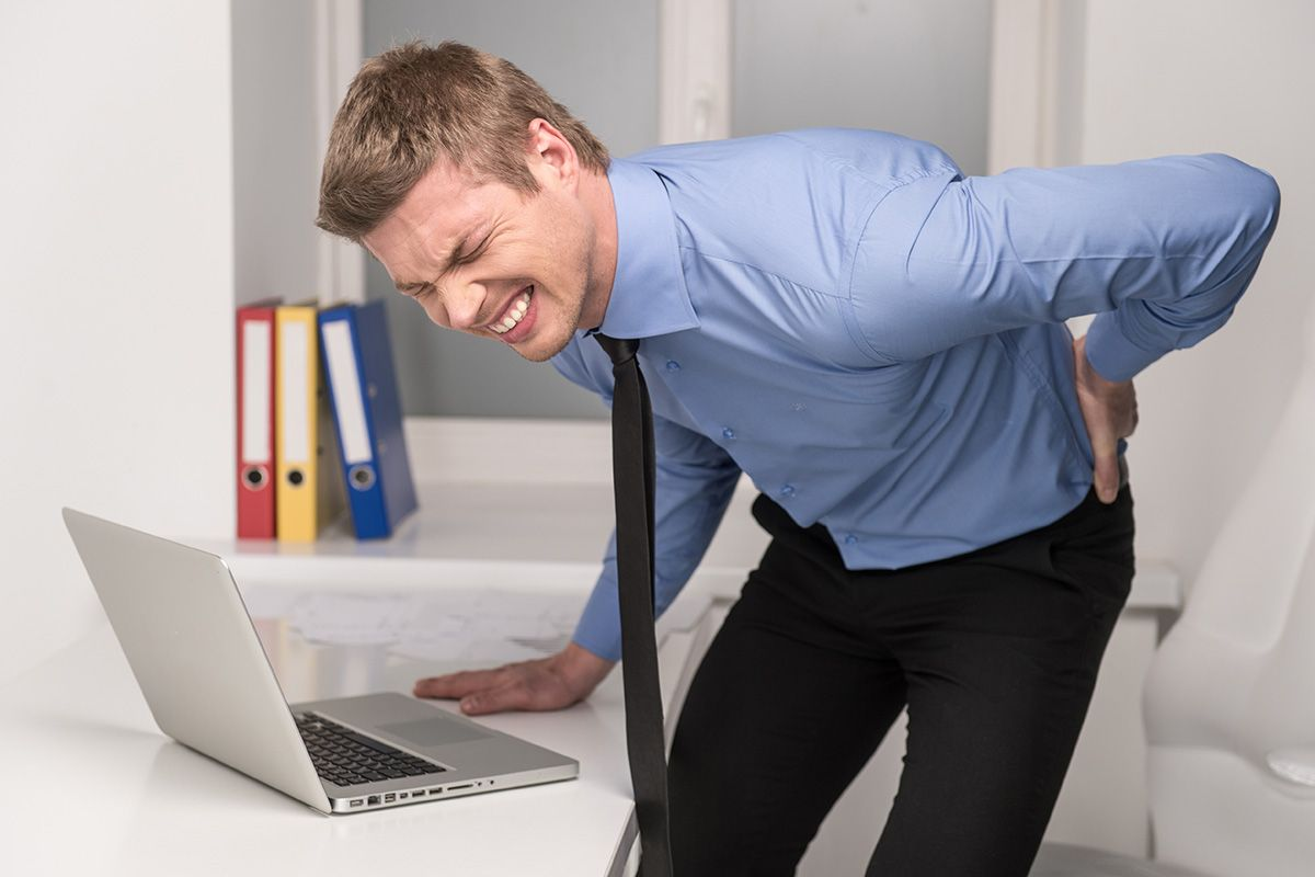 young-man-with-back-pain_1.jpg
