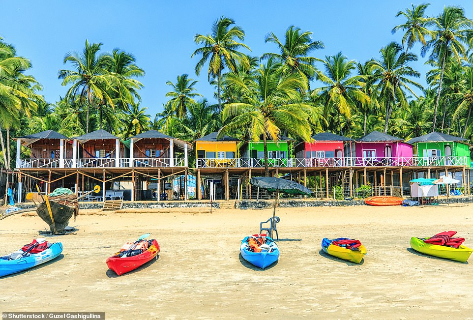 17566262-7383387-tropical_the_vibrant_rainbow_coloured_wooden_bungalows_on_palole-a-188_1568192699751.jpg