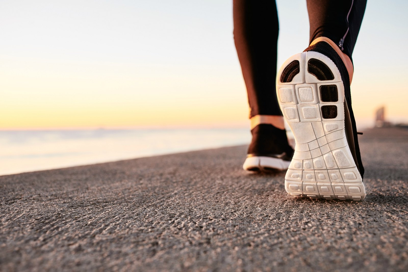 bigstock-runner-man-feet-running-on-roa-82929971.jpg